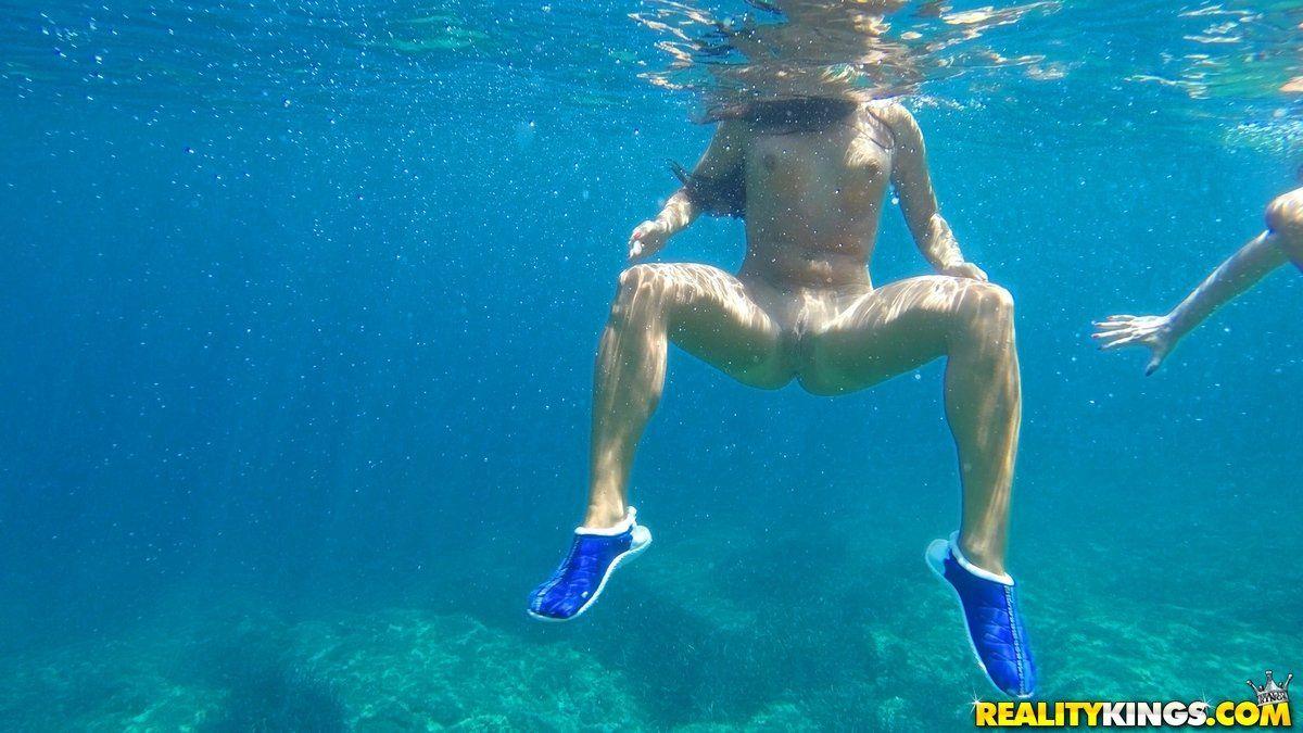 Topless Girl On Beach Stock Photo
